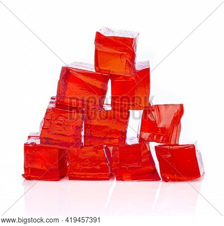 Cubes Of Red Strawberry Jelly On A White Background