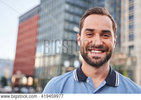 Jolly Young Man Spending Day In City Centre