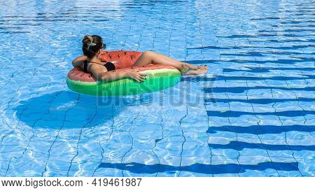 Swimming Pool Holidays. Happy Young Sexy Girl In Bikini Swimsuit, Sunglasses And Inflatable Rubber R