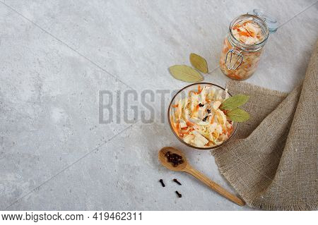 Fermented Cabbage In Bowl And Jar On A Light Background. Homemade Sauerkraut.