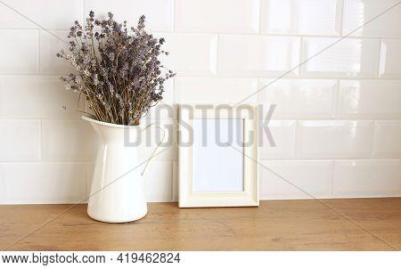 Closeup Of Kitchen Interior. White Brick Wall, Metro Tiles, Wooden Table. Portrait Empty Wooden Fram