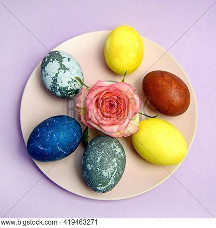 Easter Is A Minimalist Plate With Eggs Painted In Different Techniques On A Pink Pastel Plate. The C