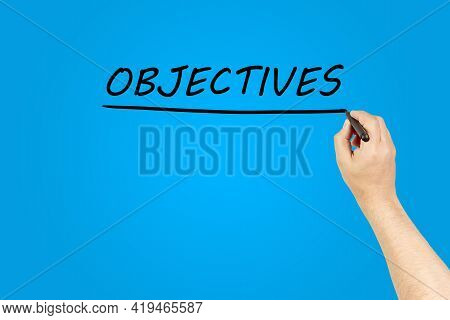 Hand Of A Man Underlining The Word Objectives On A Transparent Board. Objective Concept