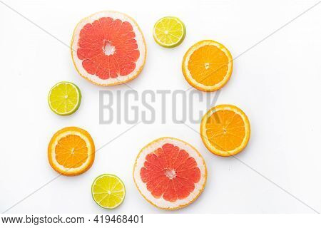 Citrus Fruits On A White Background Are Cut . Colored Fruits. The Citrus Family. Citrus Sliced Layou