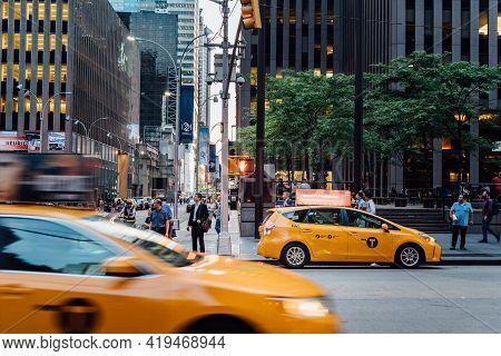 New York City, Usa - June 21, 2018: Busy Street Scene In New York City At Dusk. Yellow Cab Speeding