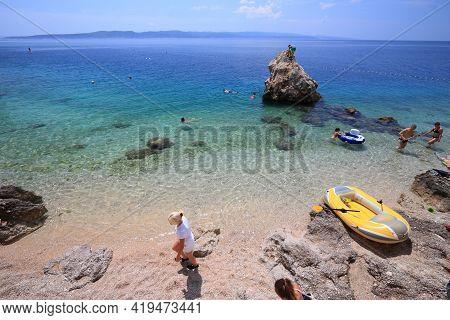 Brela, Croatia - June 18, 2019: People Spend Vacation In Brela Resort Town In Makarska Riviera Regio
