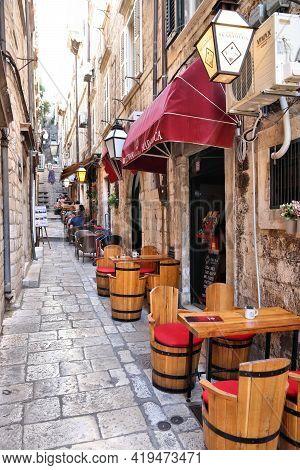 Dubrovnik, Croatia - July 26, 2019: Local Sidewalk Cafe In Dubrovnik Old Town, A Unesco World Herita