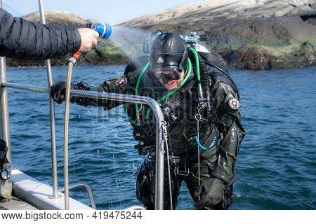 April 17, 2021 - Hamburgsund, Sweden: A Scuba Diver Have Just Return To The Dive Boat And Shower Off