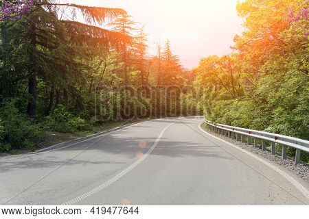 A Scenic Road Among The Forest In Summer On A Sunny Day. Beautiful Empty Highway In Nature. High Qua
