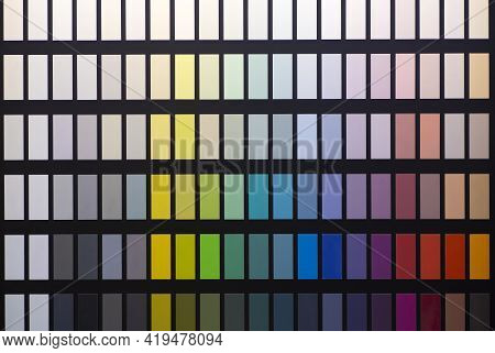 Paint Color Swatches In The Background Interior Design Studio. Selection Various Colors And Shades O