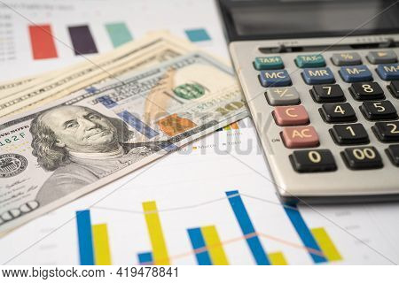 Calculator On Chart And Graph Paper. Finance Development, Banking Account, Statistics, Investment An