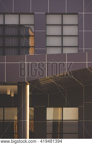 Evening Sunlight And Reflection On Surface Of Glass Wall And Brown Aluminum Composite Tile Of Modern