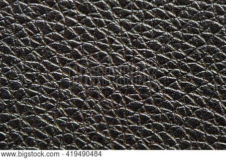 Black With Golden Highlights Artificial Leather, Dermatin Texture Macro Background Pattern For Backd