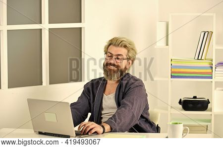 So Happy. Using Computer For Studying. Man With Laptop In Home Office. Hipster Working From Home. En