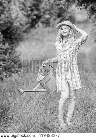 Spring Gardening Checklist. Watering Plants In Garden. Watering Tools. Girl Child Hold Watering Can.