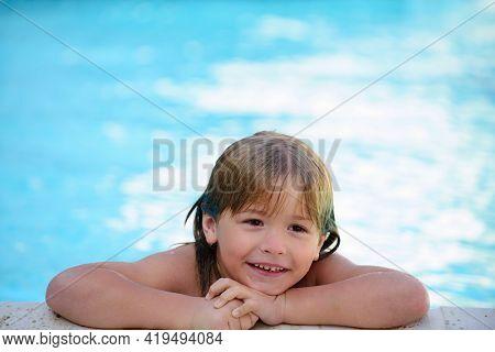 Child In Summer Pool. Pool Resort. Summer Weekend. Smilling Boy At Aquapark. Kid Swimming In Water.
