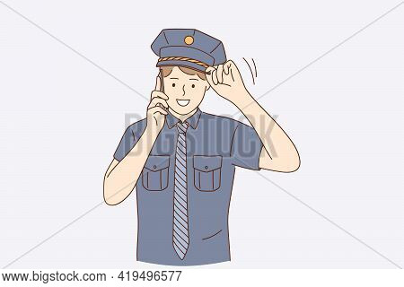 Policeman During Work Concept. Young Handsome Positive Policeman Wearing Police Uniform Talking On S