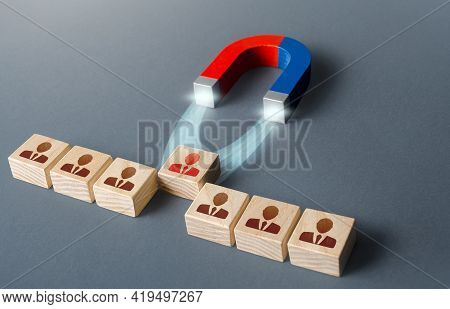 Magnet Pulls A Red Employee Out Of Row Blocks. Hiring Best Candidate. Poaching Participants From Oth