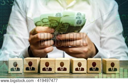 Businessman Counting Euro Money Over Employee Figures. Calculation Of The Company's Profit. Payment
