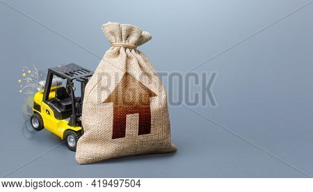 Forklift Truck Cannot Lift The Bag With House Symbol. Concept Of Inability To Maintain Housing. Repa