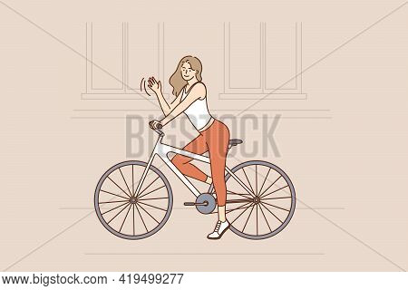 Riding Bike And Street Activities Concept. Smiling Pretty Hipster Slim Girl With Long Brown Hair Rid