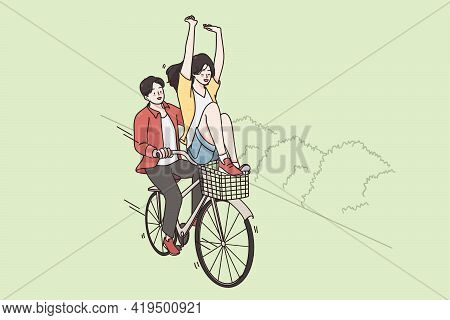 Riding Bicycle And Street Summer Activities Concept. Smiling Happy Couple Riding Fixed Gear Bicycle