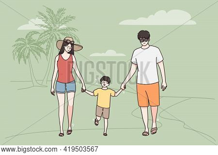 Vacation On Sea Beach With Family Concept. Young Happy Family With Small Child Boy Walking Across Se
