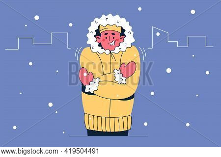 Feeling Cold And Frozen Concept. Frustrated Cold Frozen Man In Warm Clothes Standing Embracing Body