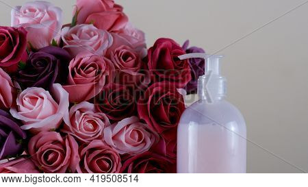 Decorative Soap In The Form Of Roses. A Bouquet Of Fragrant Soap Roses And A Bottle Of Liquid Pink S