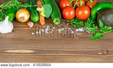 Vegetable Background Closeup. Fresh Vegetables On The Wooden Kitchen Table, Copy Space. Healthy Eati