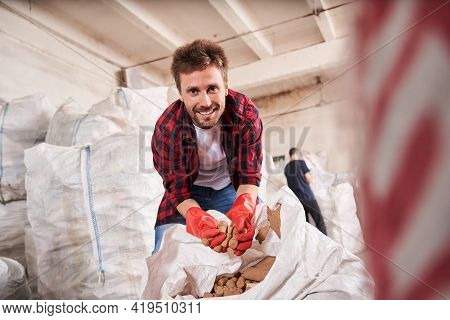 Man Holding Wine Corks In A Handful