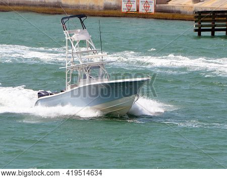 Blue Nd White Sport Fishing Boat Powered By Three Outboard Engines Speeding On Biscayne Bay Off Of M
