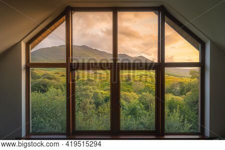 View Through The Wooden Window On Beautiful, Dramatic Sunrise Over Carrauntoohil Mountain And Macgil