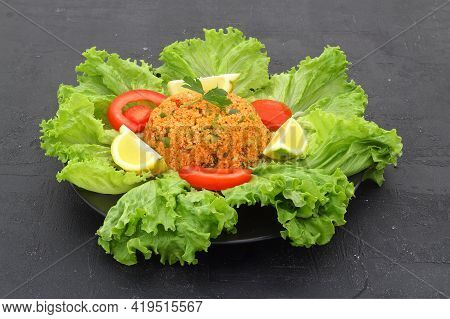 Traditional Turkish Bulgur Salad Kisir Close-up On A Plate On The Table. Horizontal View From Above