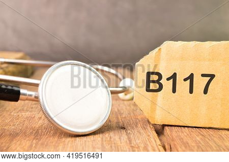 Stethoscope And Label Tag Written With B117. B117 Is A Variant Of Sars - Cov Two
