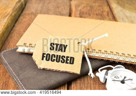 Label Tag Written With Stay Focused. Selective Focus