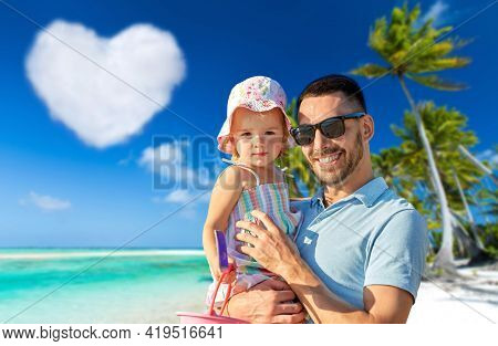 family, fatherhood and travel concept - happy smiling father with little daughter over tropical beach in french polynesia and heart shaped cloud on background