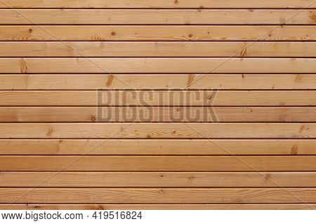 Light-brown Brand New Wooden Fence For Abstract Backgrounds And Textures. Horizontal Wall Varnished