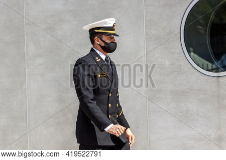 Annapolis, Md, Usa 05-02-2021: A Cadet Attending To Us Naval Academy (usna) Is Wearing A Face Mask D