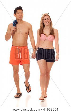 Young couple in swimwear. Studio shot over white. poster