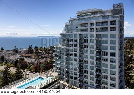 Aerial View Of Residential Homes In A Peaceful Neighborhood On The West Coast. Sunny Spring Day. Whi