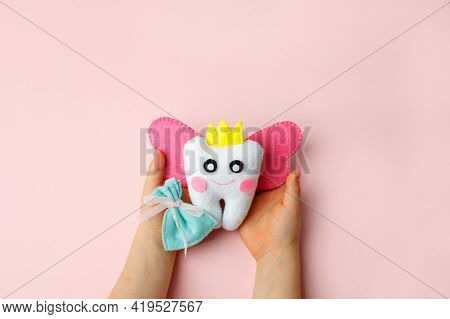 Little Child Holding Felt Tooth Fairy Toy In His Hands On Pink Background. Easy And Funny Kids Craft