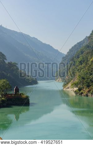 Teesta River Flowing Down From Sikkim To Darjeeling District With Lush Green Hills And Mountains On