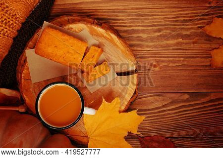 Top View Of Autumn Composition With Cup, A Pumpkin, A Pie And A Sweater. Pumpkin Juice And Sweet Fre