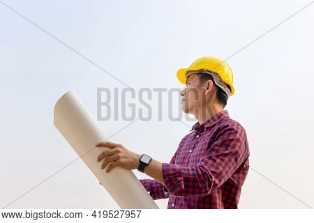 Engineer Man Holding Blueprint Checking And Planning Project At Construction Site, Man Holding Bluep