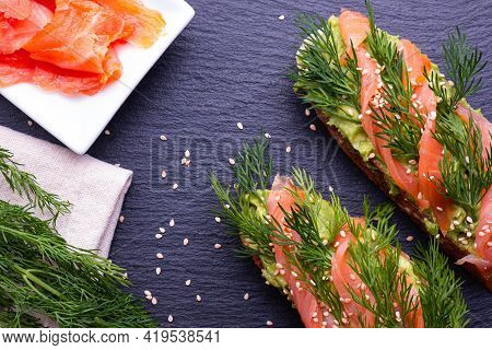 Ingredients For Canapes With Avocado And Smoked Salmon Fillet And Fresh Dill Sprigs And Sprinkled Wi