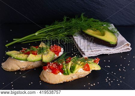 Canapes, Avocado Wedges And Tomato Slices Are Laid Out On A Piece Of Baguette, Avocado Halves And Fr