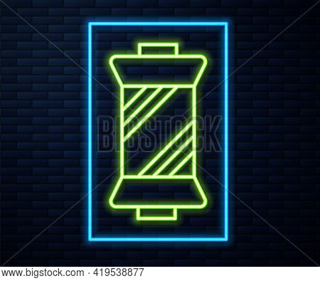 Glowing Neon Line Sewing Thread On Spool Icon Isolated On Brick Wall Background. Yarn Spool. Thread