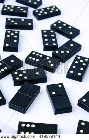 Domino Dice Black With White Dots On White Background. Selective Focus. Table Games For Company Of F