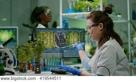 Biologist Scientist Putting Solution Liquid In Test Tube